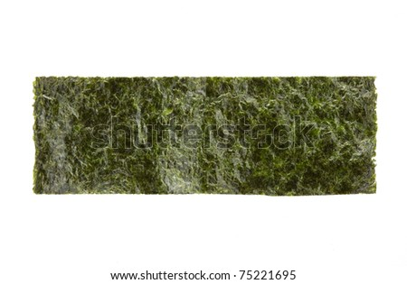 A piece of seasoned dried seaweed isolated on white - stock photo