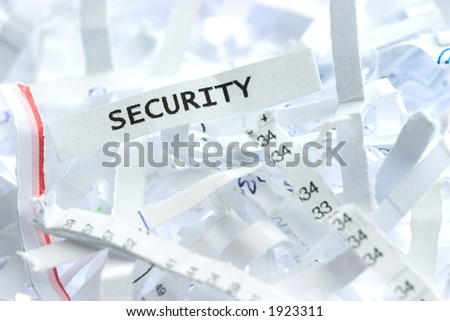 "A piece of shredded paper with a word ""security"" written on it. - stock photo"