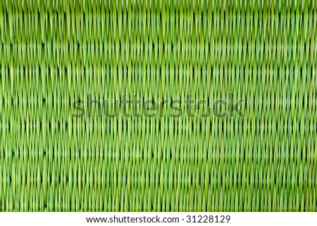 a piece of straw mat in light green color. - stock photo