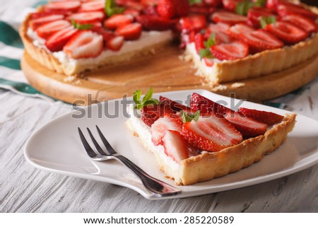 a piece of strawberry tart with cream cheese on a plate close-up. Horizontal