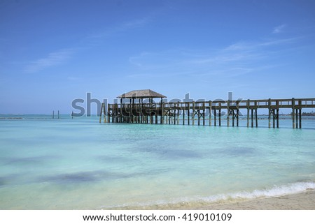A pier in the Bahamas. - stock photo