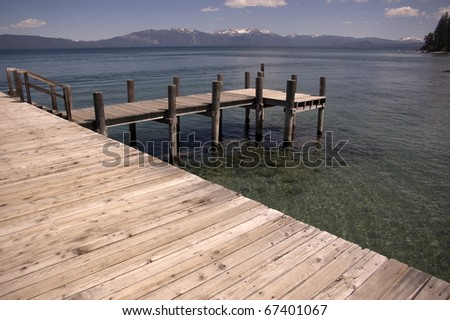 A pier on Lake Tahoe that straddles Nevada and California - stock photo