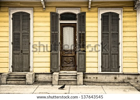A pigeon walking past old architecture in the French Quarter in New Orleans - stock photo