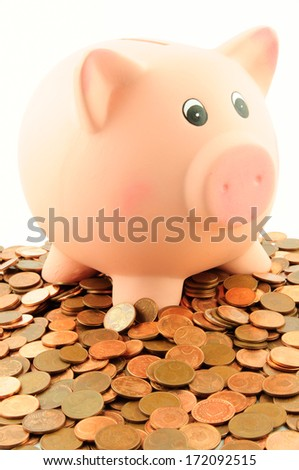 A piggy bank on a pile of euro cent coins isolated on white.  Business & Finance Collection