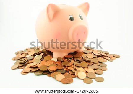A piggy bank on a pile of euro cent coins isolated on white.  Business & Finance Collection - stock photo