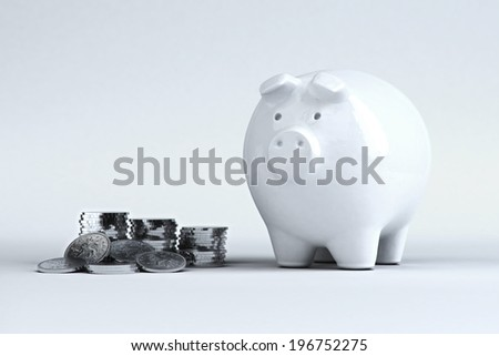 A piggy bank on a white background with coins - stock photo