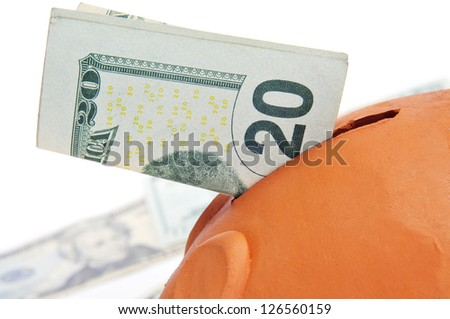 a piggy bank with a 20 dollar bill - stock photo