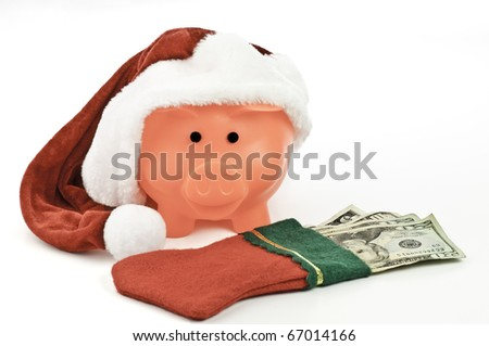 A piggy bank with a gift of money for Christmas - stock photo