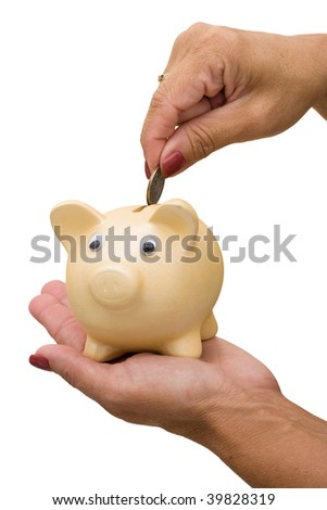 A piggy bank with a hand inserting money in it on a white background, savings