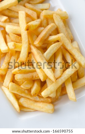 a pile of appetizing french fries on white plate