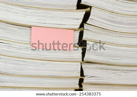 A pile of archival documents with blank bookmark - stock photo