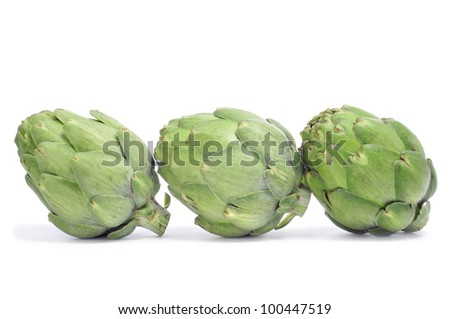 a pile of artichokes on a white background - stock photo