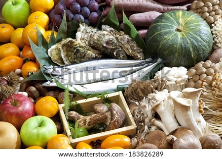 A pile of assorted fruits and vegetables with fish. - stock photo