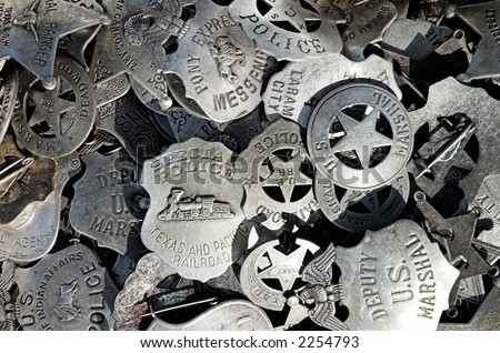 A pile of badges at a street market - stock photo