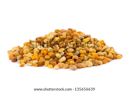 A pile of bee pollen granules. Bee Pollen is one of the richest and purest natural foods ever discovered, and the incredible nutritional and medicinal value of pollen has been known for centuries. - stock photo