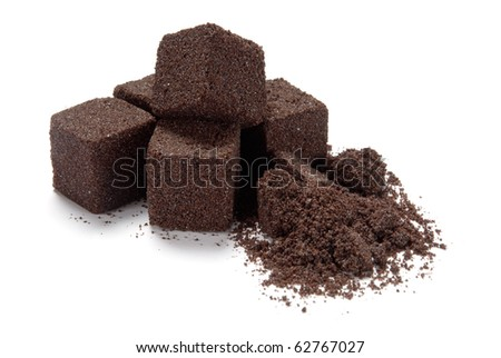 A pile of beef stock or boullion cubes on white background