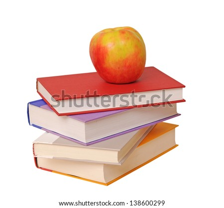a pile of books and apple isolated on white background