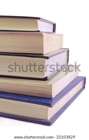 A pile of books isolated on white background - stock photo