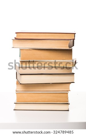 A pile of books on white background