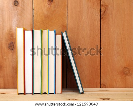 a pile of books on wooden table - stock photo