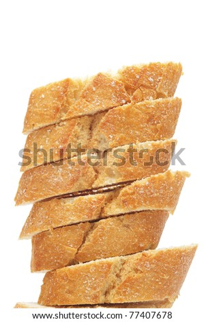 a pile of bread slices on a white background - stock photo