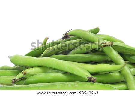 a pile of broad bean pods on a white background - stock photo