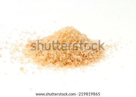 a pile of brown sugar on white background