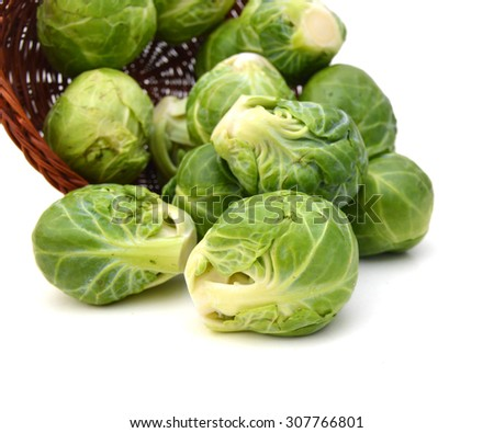 a pile of Brussels sprouts in basket on a white background - stock photo