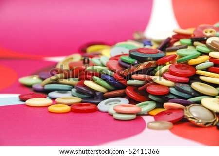 a pile of buttons of many colors on a colors background - stock photo