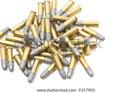 A pile of 22 caliber cartridges - stock photo