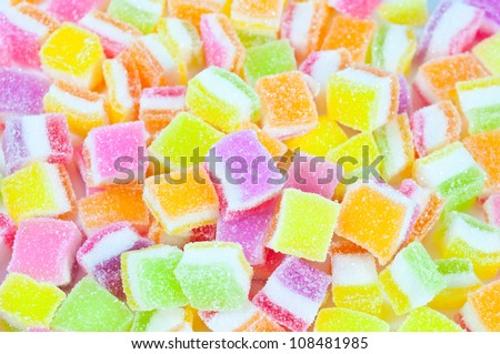 A pile of candies on a white background. Close-up of colorful candy . - stock photo