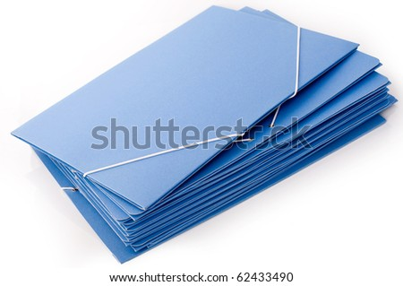 A pile of cardboard blue folders with elastic bands - stock photo