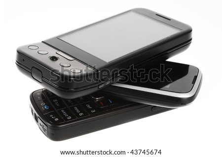 A pile of cell phones isolated on white background - stock photo