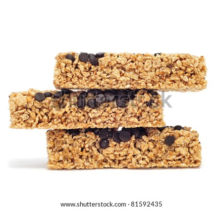 a pile of cereal bars on a white background - stock photo
