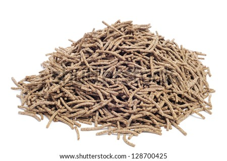 a pile of cereal bran sticks on a white background