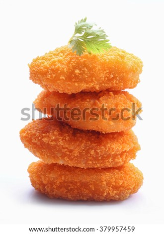 A pile of chicken nuggets isolated on a white background - stock photo