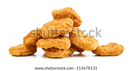a pile of chicken nuggets on a white background  - stock photo