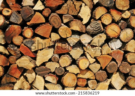 a pile of chopped firewood logs - stock photo