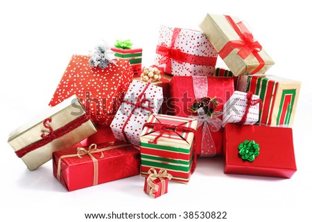 A pile of Christmas gifts in colorful wrapping with ribbons. - stock photo