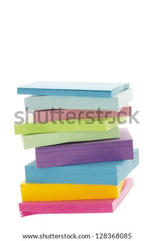 A pile of colorful adhesive paper isolated over the white background - stock photo