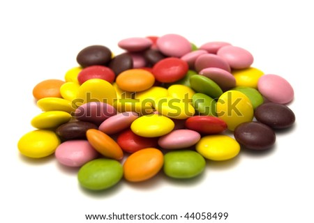 A pile of colorful chewy dragees isolated on a white background. - stock photo
