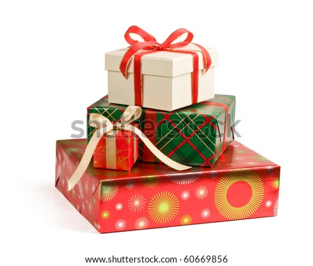 A pile of colorful Christmas gifts isolated on white background. - stock photo