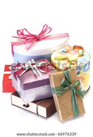 A pile of colorful gifts isolated on white background.