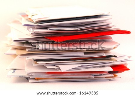 A pile of colorful letters and junk mail on a table isolated on white background - stock photo