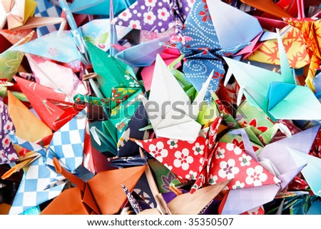 A pile of colorful origami birds - stock photo