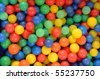 A pile of colorful plastic balls - stock photo