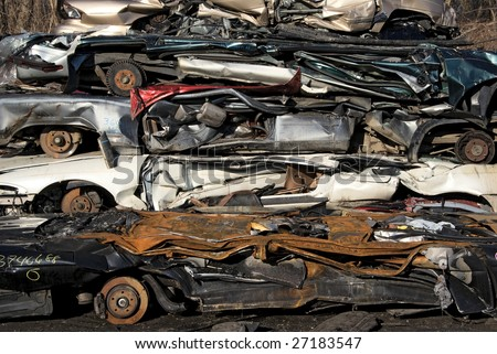 A pile of compressed car going to be shredded - stock photo