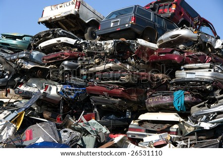 A pile of compressed cars going to be shredded - stock photo