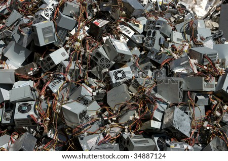 A pile of computer power supply boxes for recycling - stock photo
