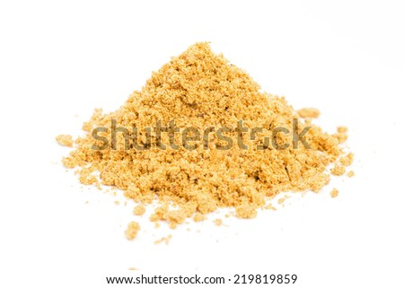 a pile of curry powder on white background - stock photo